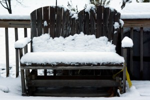 wood chair with snow